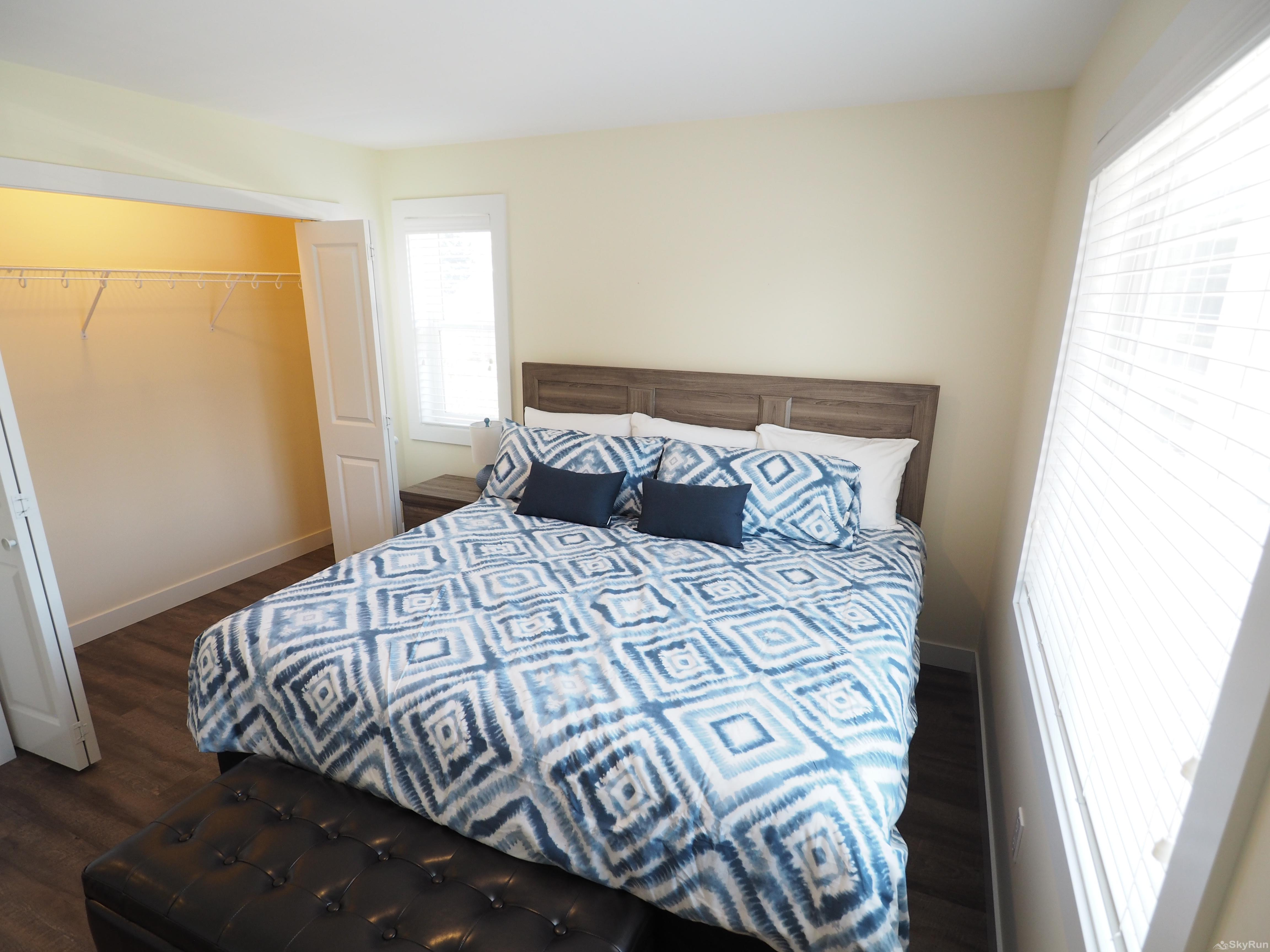 Blue Heron Hide-Away Full closet in the first bedroom as well as extra storage in the chest at the foot of the bed