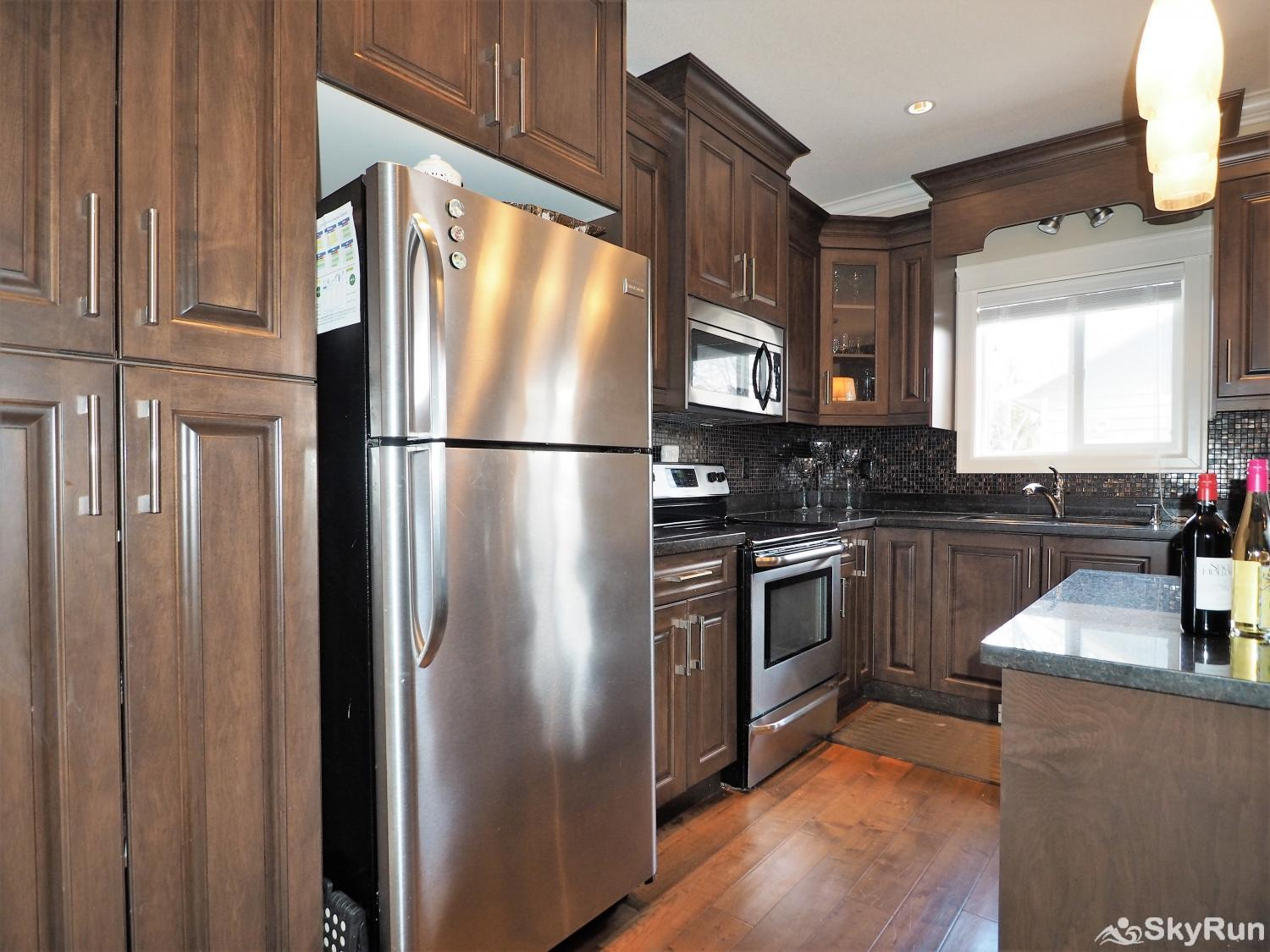 Old Summerland 4 bedroom townhouse The large fridge in the main kitchen provides space for everything you need